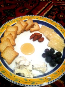 Cheese plate with cheese, fruit and crackers